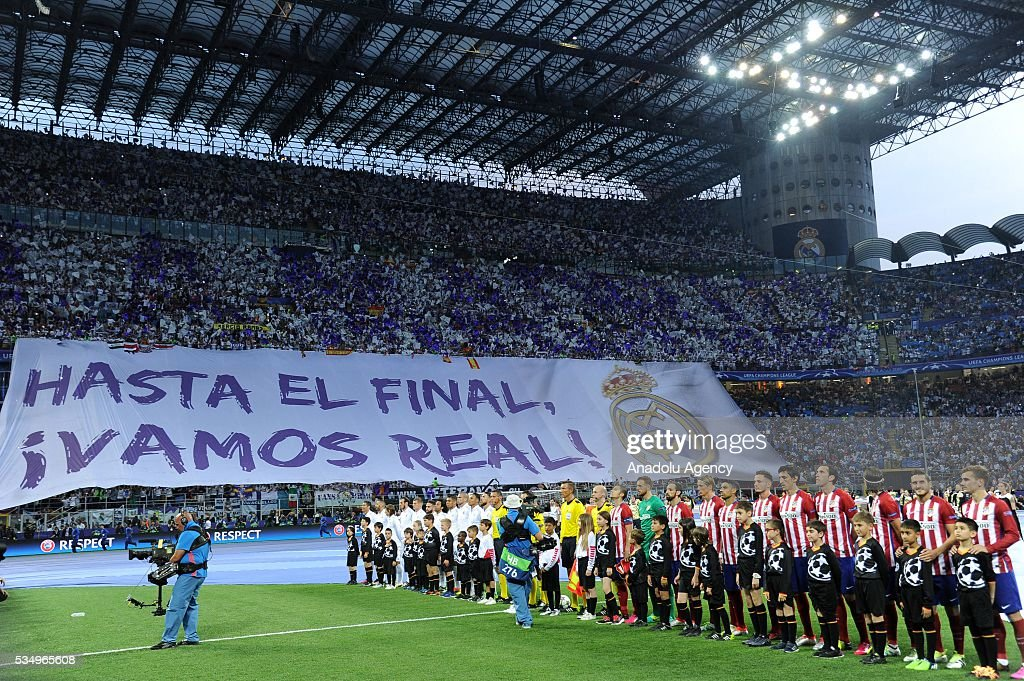 Players stand during the anthem singing ceremony prior to the UEFA Champions League Final between Real Madrid CF and Atletico Madrid at the Giuseppe Meazza Stadium in Milan, Italy on May 28, 2016 in Milan, Italy.