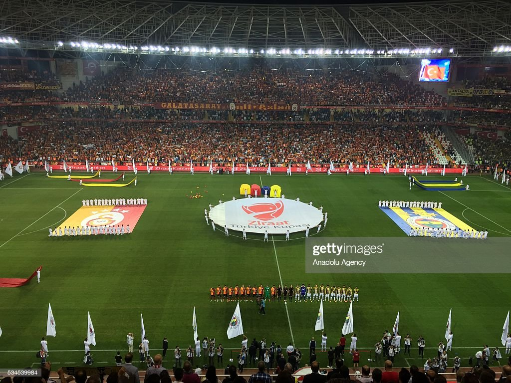 Players stand during the anthem singing ceremony prior to the Ziraat Turkish Cup Final match between Galatasaray and Fenerbahce at Antalya Ataturk Stadium in Antalya, Turkey on May 26, 2016.