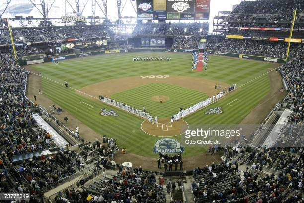 Players stand during the National Anthem prior to the opening day game between the Seattle Mariners and the Oakland A's at Safeco Field April 2 2007...
