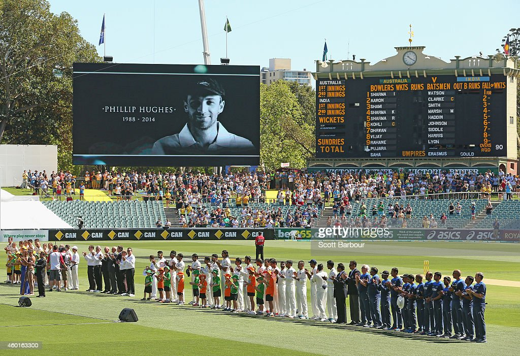 Players stand for 63 seconds of applause in memory of <a gi-track='captionPersonalityLinkClicked' href=/galleries/search?phrase=Phillip+Hughes+-+Cricketspeler&family=editorial&specificpeople=757530 ng-click='$event.stopPropagation()'>Phillip Hughes</a> during day one of the First Test match between Australia and India at the Adelaide Oval on December 9, 2014 in Adelaide, Australia. Australian cricketer <a gi-track='captionPersonalityLinkClicked' href=/galleries/search?phrase=Phillip+Hughes+-+Cricketspeler&family=editorial&specificpeople=757530 ng-click='$event.stopPropagation()'>Phillip Hughes</a> passed away, aged 25, as a result of head injuries sustained during the Sheffield Shield match between South Australia and New South Wales at the SCG on Tuesday 25th November.