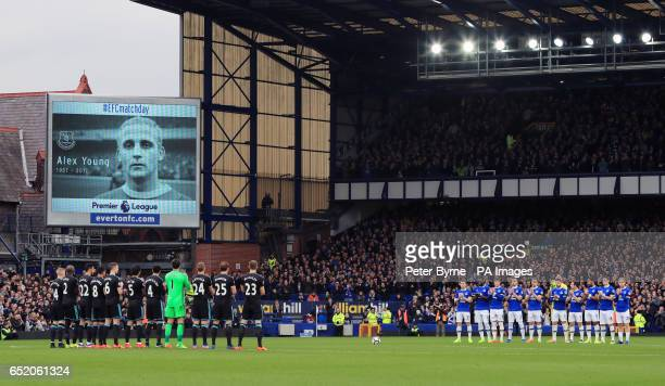 Players stand for a minute's applause in memory of former Everton planer Alex Young before the Premier League match at Goodison Park Liverpool