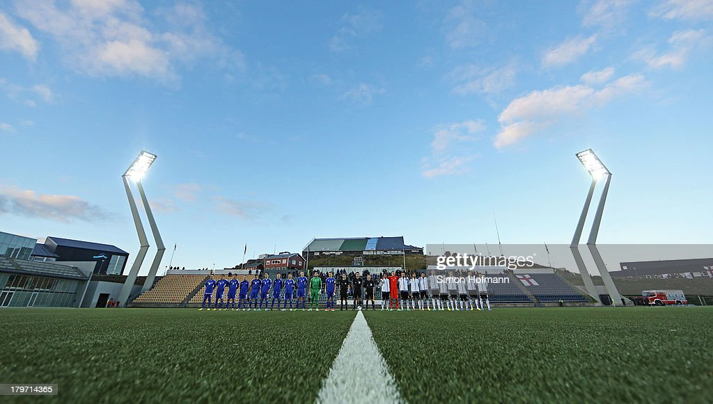 Players stand for the national anthems prior to the UEFA Under21 Euro 2015 Qualifier match between Faroe Islands and Germany at Torsvollur Stadium on...