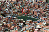 Players stand on a soccer field surrounded by buildings in this elevated view of La Paz Bolivia on Monday July 8 2013 Central bank President Marcelo...