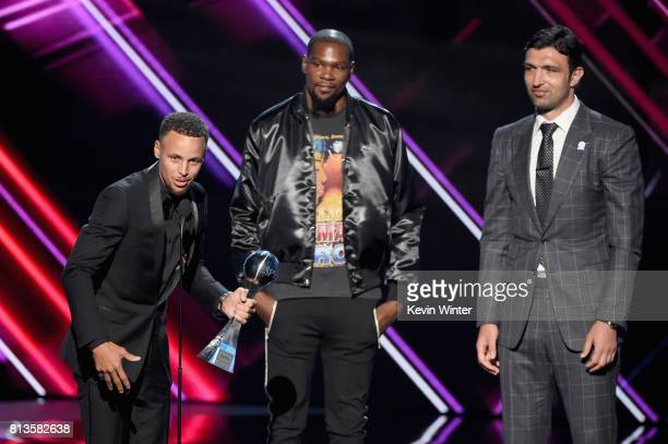 NBA players Steph Curry Kevin Durant and Zaza Pachulia accept the Best Team award on behalf of the NBA champion Golden State Warriors onstage at The...