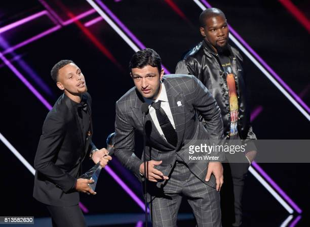 NBA players Steph Curry Zaza Pachulia and Kevin Durant accept the Best Team award on behalf of the NBA champion Golden State Warriors onstage at The...