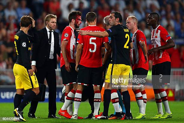 Players surround an injured Davy Propper of PSV Eindhoven during the UEFA Champions League Group D match between PSV Eindhoven and Club Atletico de...