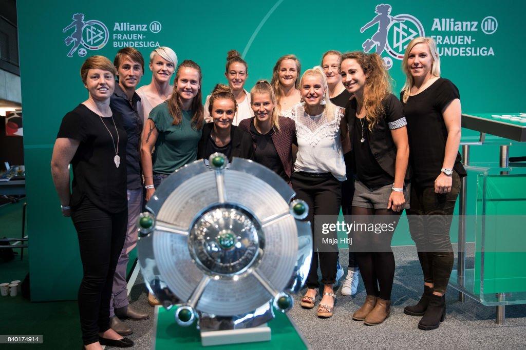 Players Susann Utes (FF USV Jena) (L-R), Anne van Bonn (SC Sand), Nilla Fischer (VfL Wolfsburg), Kathleen Radtke (MSV Duisburg), Lina Magull (SC Freiburg), Felicitas Rauch (FFC Turbine Potsdam), Marie-Louise Eta (Bremen), Sophie Howard - (TSG 1899 Hoffenheim), Ina Lehmann (SGS Essen), Melanie Behringer (FC Bayern Muenchen), Julia Arnold (FC Koeln) and Marith Priessen (1. FFC Frankfurt) pose next to the 1. Frauen Bundesliga Trophy on occasion of Allianz Frauen Bundesliga Season Opening at Deutsches Fussballmuseum on August 28, 2017 in Dortmund, Germany.