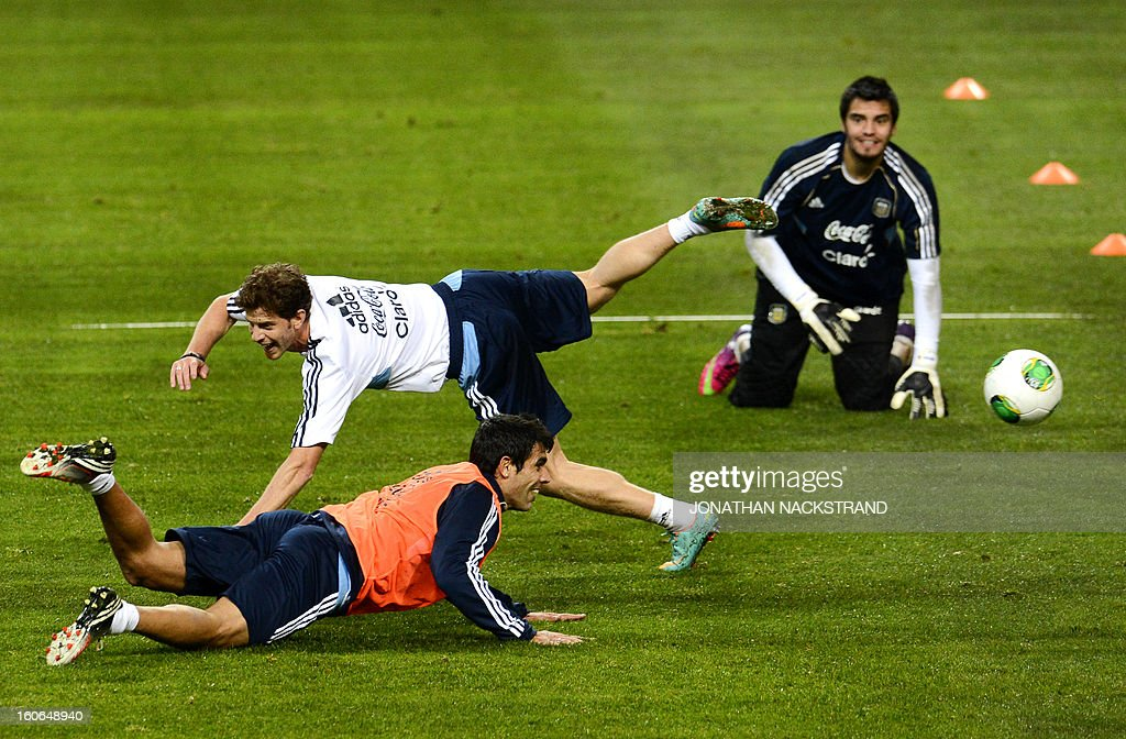 Players take part in a training session of the Argentina national football team at the 'Friends Arena' in Stockholm, Sweden, on February 4, 2013 two days before the FIFA World Cup 2014 friendly match Sweden vs Argentina. AFP PHOTO/JONATHAN NACKSTRAND