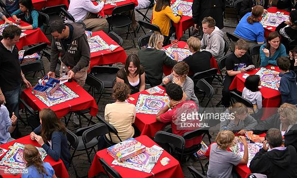 Players take part in a worldwide bid to set a new Guinness World Record for most people playing the board game 'Monopoly' simultaneously in Covent...