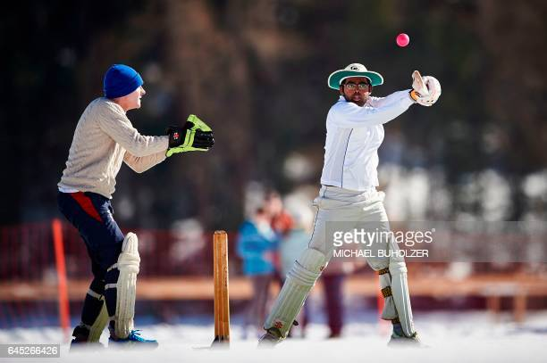 Players take part in the 30th Cricket on Ice tournament held on the frozen surface of the Lake St Moritz on February 25 2017 The tournament first...