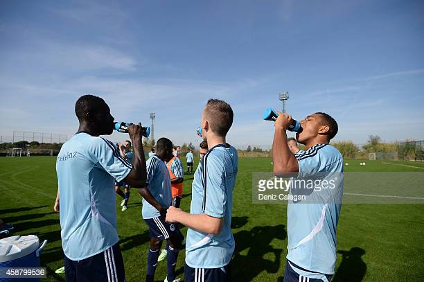 Players take refreshment during a training session of the U18 team of Germany on November 11 2014 in Belek Turkey