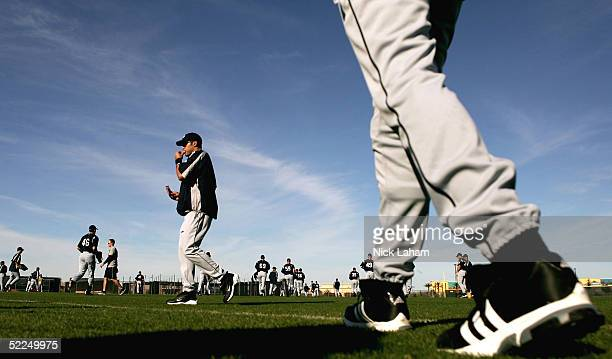 Players take the field during Seattle Mariners spring training on February 27 2005 at Peoria Stadium in Peoria Arizona