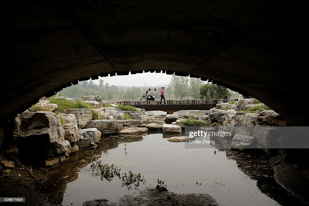 Players through the bridge during the final round of the Volvo China open at Topwin Golf and Country Club on May 1, 2016 in Beijing, China.