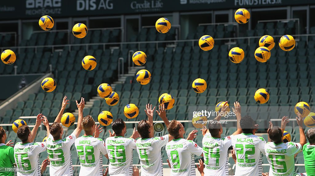 Players throw balls during the Borussia Moenchengladbach team presentation on July 9, 2013 in Moenchengladbach, Germany.