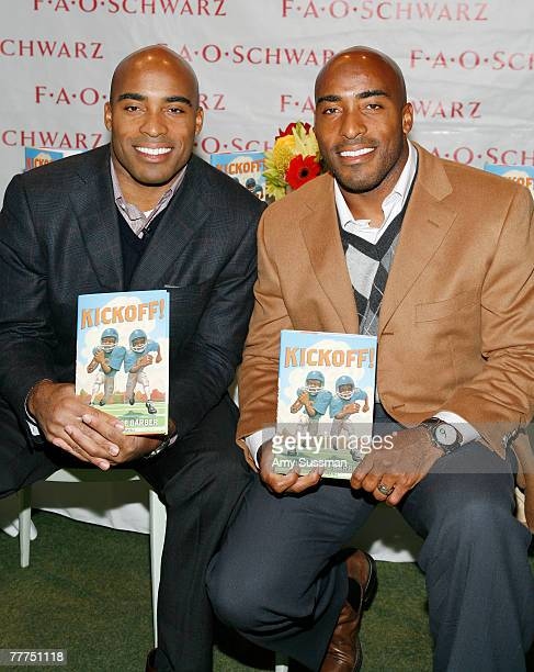NFL players Tiki and Ronde Barber pose with their new book 'Kickoff' at FAO Schwarz on November 6 2007 in New York City