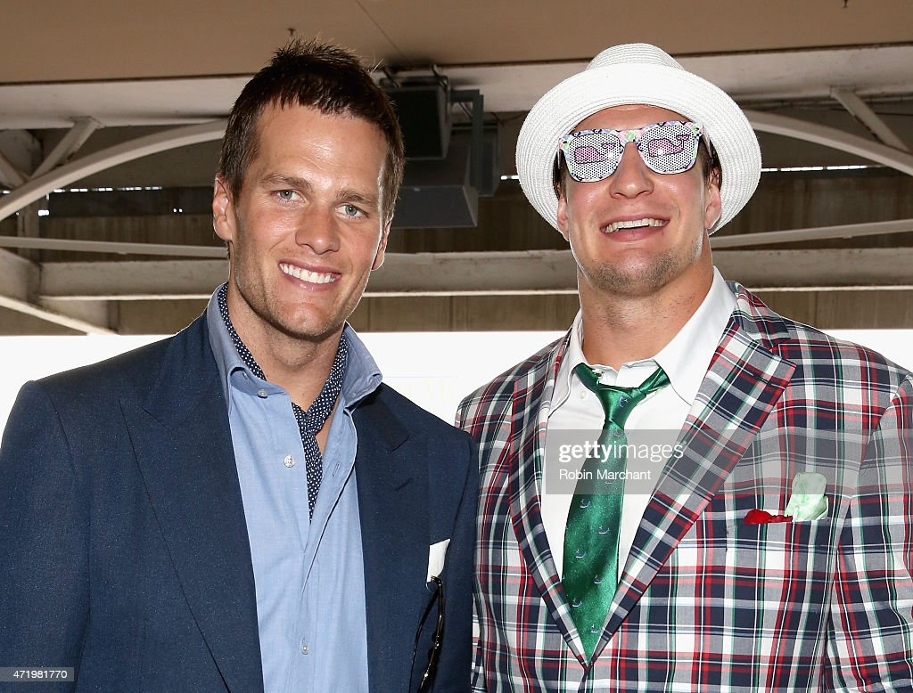NFL players <a gi-track='captionPersonalityLinkClicked' href=/galleries/search?phrase=Tom+Brady+-+American+Football+Quarterback&family=editorial&specificpeople=201737 ng-click='$event.stopPropagation()'>Tom Brady</a> (L) and <a gi-track='captionPersonalityLinkClicked' href=/galleries/search?phrase=Rob+Gronkowski&family=editorial&specificpeople=5534525 ng-click='$event.stopPropagation()'>Rob Gronkowski</a> attend the 141st Kentucky Derby at Churchill Downs on May 2, 2015 in Louisville, Kentucky.