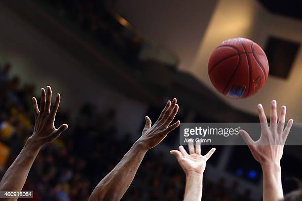 Players try to catch the ball during the Beko BBL basketball match between MHP Riesen Ludwigsburg and Fraport Skyliners at MHP Arena on December 30...