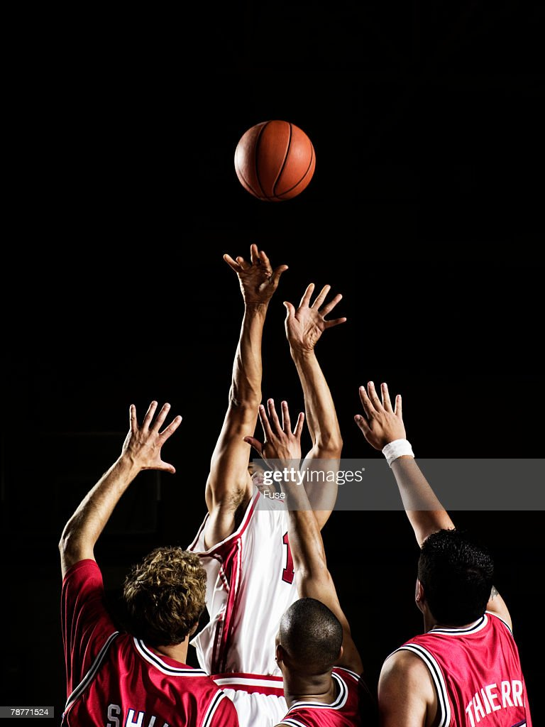 Players Trying to Block Shot