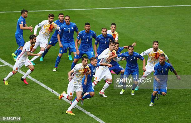 Players tussle during the UEFA EURO 2016 round of 16 match between Italy and Spain at Stade de France on June 27 2016 in Paris France