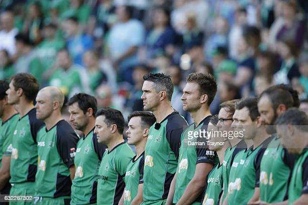 Players umpires and fans stand for a minutes silence before the Big Bash League match between the Melbourne Stars and the Sydney Sixers at Melbourne...