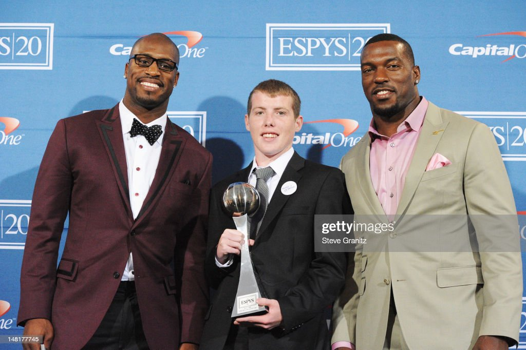 NFL players Vernon Davis and Patrick Willis of the San Francisco 49ers and Jimmy Murphy pose in the press room during the 2012 ESPY Awards at Nokia...