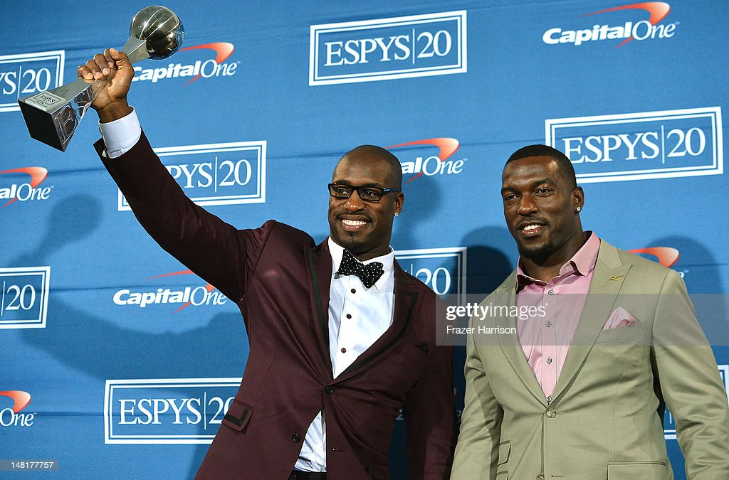 NFL players Vernon Davis and Patrick Willis with award for Best Game poses in the press room during the 2012 ESPY Awards at Nokia Theatre LA Live on...