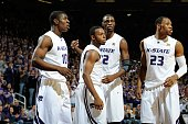Players Victor Ojeleye Jacob Pullen Jamar Samuels and Dominique Sutton of the Kansas State Wildcats look to the bench during a game against the Texas...