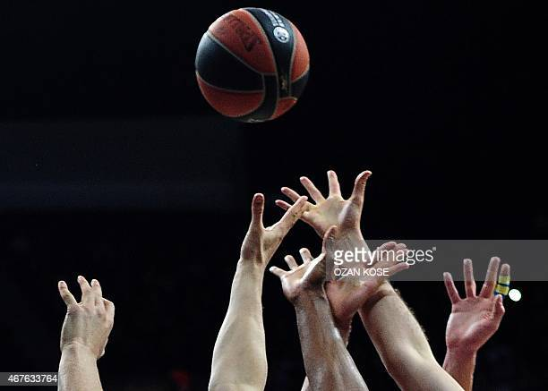 PLayers vie during the Euroleague basketball match between Fenerbahce Ulker and Unicaja Malaga at Fenerbahce Ulker Sports Arena in Istanbul on March...