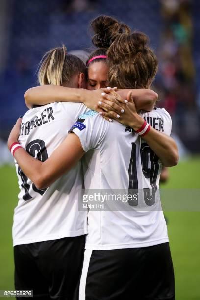 Players Virginia Kirchberger Jasmin Eder and Verena Aschauer of Austria react after the UEFA Women's Euro 2017 Semi Final match between Denmark and...