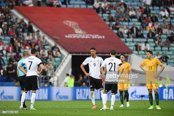 Players wait for a decision on a goal by video assistant referees during the 2017 Confederations Cup group B football match between Australia and...