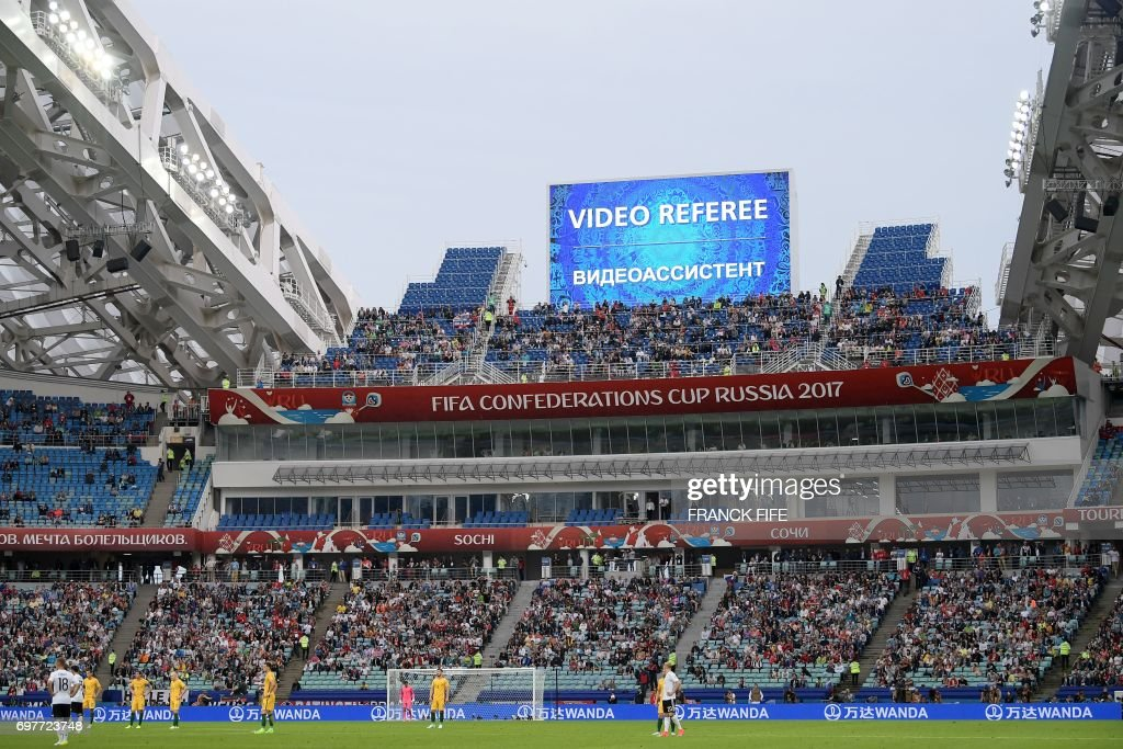 Players wait for a decision on a goal by video assistant referees during the 2017 Confederations Cup group B football match between Australia and Germany at the Fisht Stadium in Sochi on June 19, 2017. /