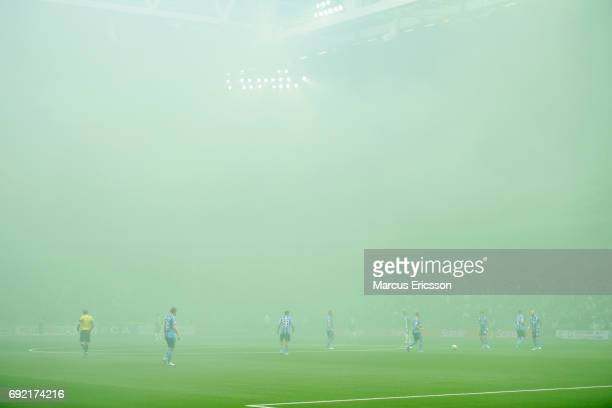 Players waiting for smoke to clear before the Allsvenskan match between Hammarby IF and Djurgardens IF at Tele2 Arena on June 4 2017 in Stockholm...
