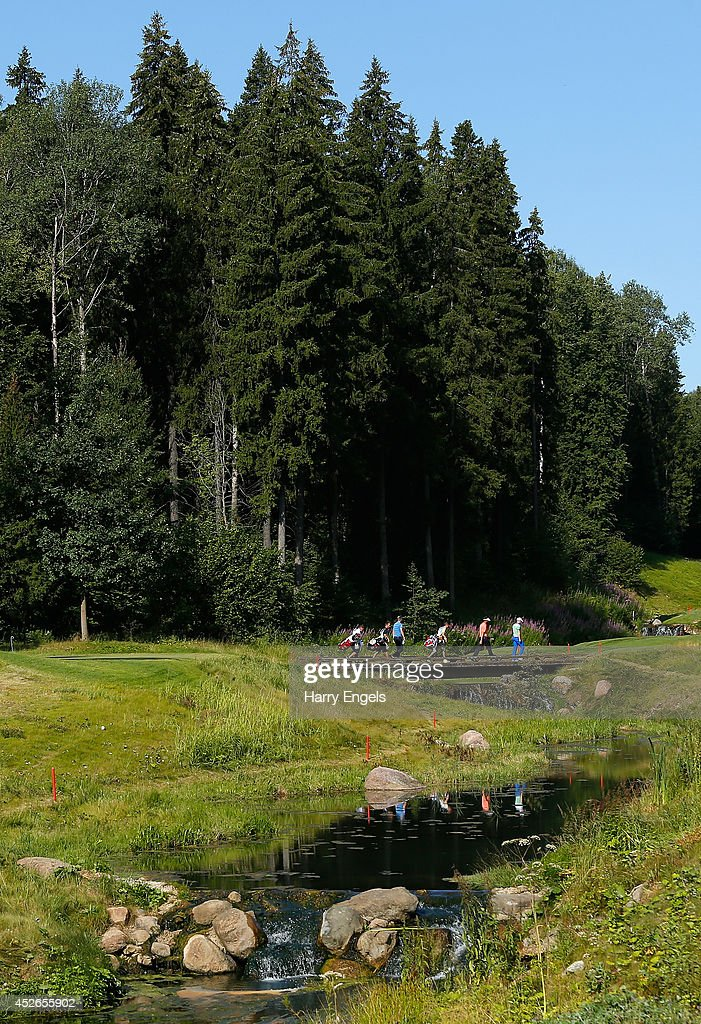 Players walk across a bridge at the eleventh on day two of the M2M Russian Open at Tseleevo Golf & Polo Club on July 25, 2014 in Moscow, Russia.