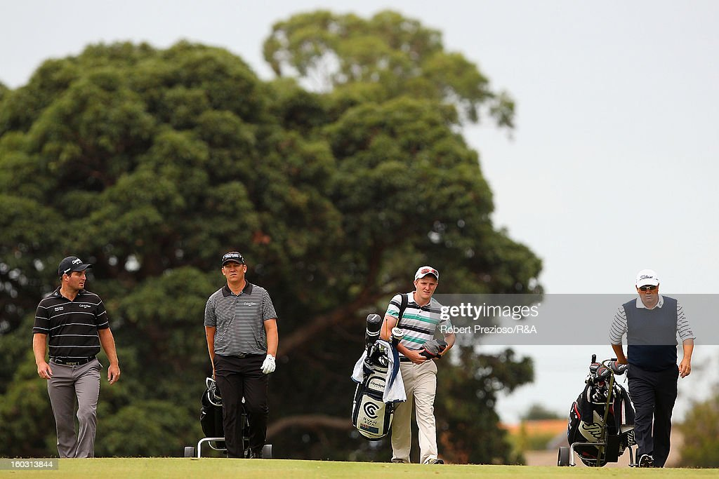 Players walk down the 17th hole during the Open International Final Qualifying Australasia day one at Kingston Heath Golf Club on January 29, 2013 in Melbourne, Australia.