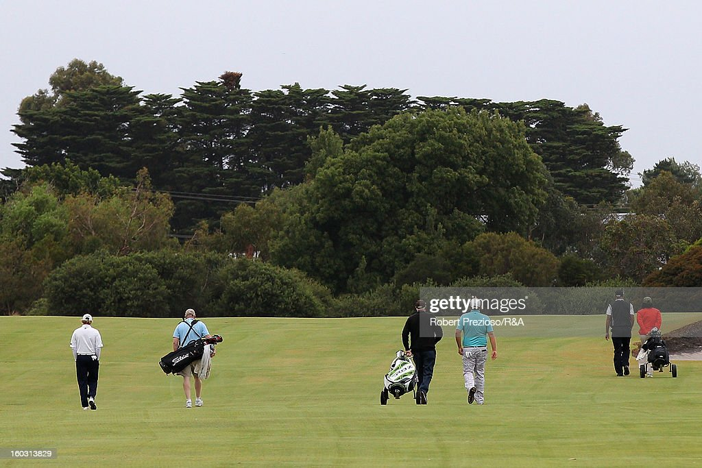 Players walk down the first hole during the Open International Final Qualifying Australasia day one at Kingston Heath Golf Club on January 29, 2013 in Melbourne, Australia.