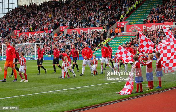 Players walk into the pitch prior to the Barclays Premier League match between Stoke City and AFC Bournemouth at Britannia Stadium on September 26...