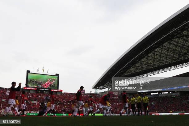 Players walk into the pitch prior to the JLeague J1 match between Urawa Red Diamonds and Consadole Sapporo at Saitama Stadium on April 22 2017 in...