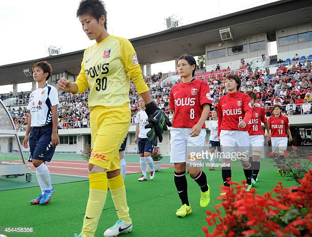 Players walk into the pitch prior to the Nadeshiko League Exciting Series match between Urawa Red Diamonds Ladies and INAC Kobe Leonessa at Saitama...