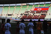 Players walk into the pitch while North Korean supporters cheer prior to the AFC Women's Olympic Final Qualification Round match between Vietnam and...