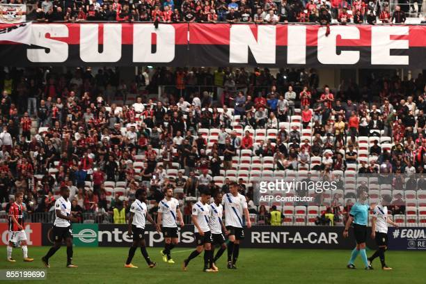 Players walk off the pitch after a power failure during the UEFA Europa League group K football match between Nice and Vitesse Arnhem at The Allianz...