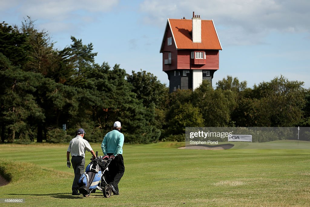 Players walk onto the eighteenth green during day two of the PGA Super 60's Tournament at Thorpeness Hotel and Golf Club on August 15, 2014 in Thorpeness, England.
