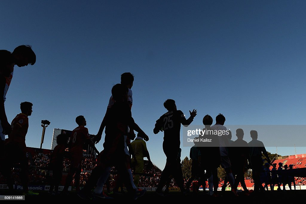 Players walk onto the pitch prior to the AFC Champions League playoff match between Adelaide United and Shandong Luneng at Coopers Stadium on February 9, 2016 in Adelaide, Australia.