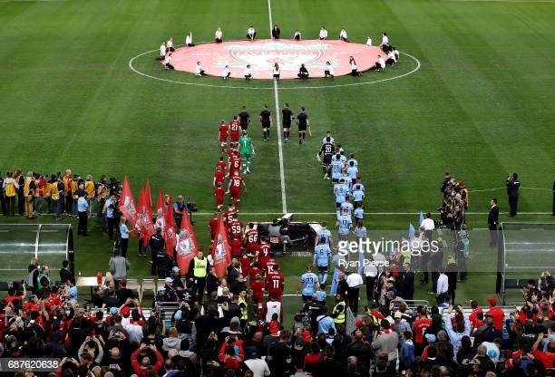 Players walk out onto the ground during the International Friendly match between Sydney FC and Liverpool FC at ANZ Stadium on May 24 2017 in Sydney...
