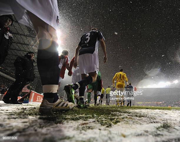 Players walk out onto the pitch as the snow falls ahead of the Barclays Premier League match between Stoke City and Fulham at The Britannia Stadium...