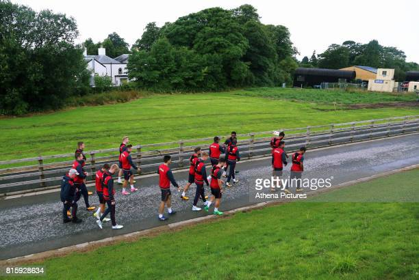 Players walk to the pitch during the Swansea City Training at The Fairwood Training Ground on July 11 2017 in Swansea Wales