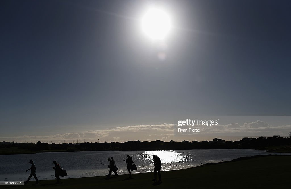 Players walk up the 11th fairway during round one of the 2012 Australian Open at The Lakes Golf Club on December 6, 2012 in Sydney, Australia.