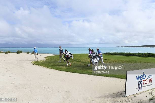 Players walk up the 11th hole during the final round of The Bahamas Great Exuma Classic at Sandals Emerald Bay Course on January 11 2017 in Great...