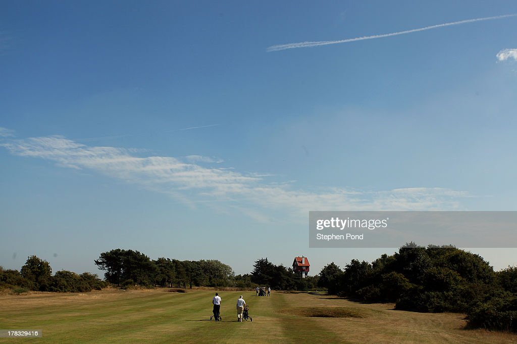Players walk up the fairway on the eighteenth hole during the PGA Super 60's Tournament at Thorpeness Hotel and Golf Club on August 29, 2013 in Thorpeness, England.