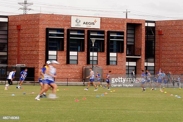 Players warm up before a North Melbourne Kangaroos AFL training session at Arden Street Ground on March 27 2014 in Melbourne Australia