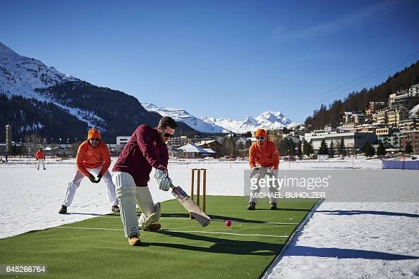 TOPSHOT Players warm up before the 30th Cricket on Ice tournament held on the frozen surface of the Lake St Moritz on February 25 2017 The tournament...